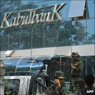 Armed guards outside the main branch of the Kabul Bank