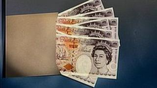 Ten pound notes in an envelope