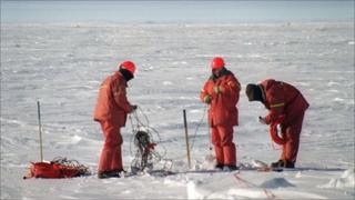 Workers look for gas and other underground deposits on the frozen Beaufort Sea
