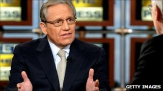 Tom Brokaw (R) listens as Bob Woodward speaks during a taping of 'Meet the Press' at the NBC studios September 14, 2008 in Washington