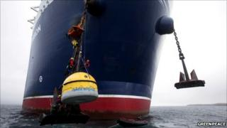 Greenpeace protesters attached to anchor