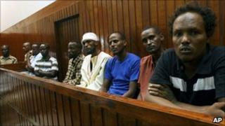 Seven Somali pirates sit in the dock at the Mombasa Law Courts, 23 September 2010 in Mombasa, Kenya