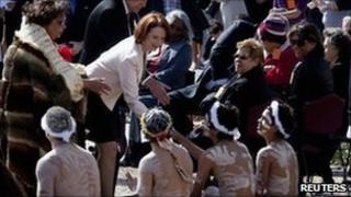 Australian PM Julia Gillard greets indigenous dancers at Parliament House in Canberra. Photo: 28 September 2010