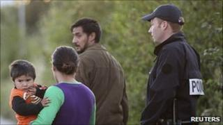 Police evacuate a Roma family from an illegal camp in Villeneuve d'Ascq, northern France, 24 Aug 10