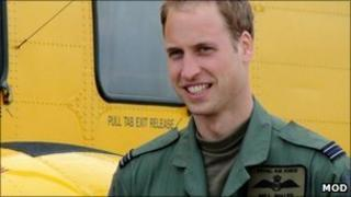 Prince William next to a rescue helicopter