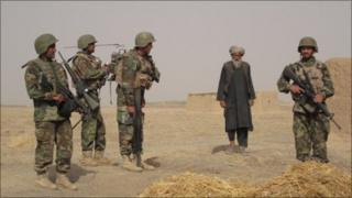 ANA soldiers about to search a compound in formally Taleban controlled territory outside Kandahar
