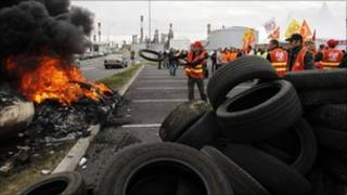 Striking workers of French oil giant Total set up a burning barricade to block the entrance of the oil refinery of Donges, near Nantes, October 18, 2010