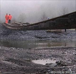 Rail engineers inspect a damaged rail line (Image: RGS)