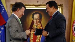 Colombian President Juan Manuel Santos (left) and Venezuelan President Hugo Chavez exchange bilateral agreements at Miraflores presidential palace in Caracas, Venezuela on 2 November, 2010