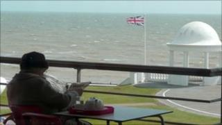 Pensioner on a balcony in Bexhill