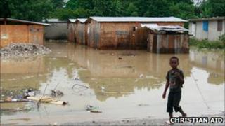 Boy near a flooded area in Leogane, Haiti (photo: Christian Aid/Susan Barry)