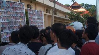 People search picture boards for missing relatives