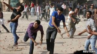 Christian demonstrators throw stones at police in Cairo - 24 November 2010