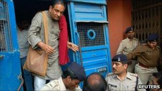 Dr Binayak Sen is brought to a court in the Indian city of Raipur on 24 December 2010