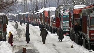 Trucks stranded in the snow in Indian-administered Kashmir