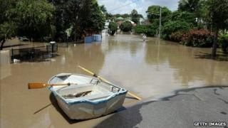 A boat is seen in a flooded street in a Brisbane suburb