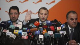 Energy Minister Gibran Bassil (centre) announces the resignations (12 January 2011)