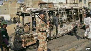 A bus burned by a mob reacting to the target killing of an MQM worker in Karachi on 8 Jan 2011