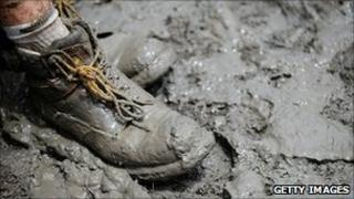 The foot of a volunteer in mud in the city of Rockhampton on 16 January 2011