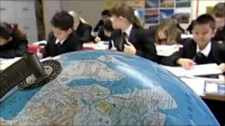 Children in class with globe