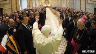 Pope Benedict XVI waves at the end of a special audience with members of the Italian Police