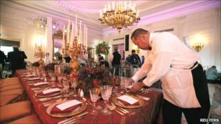Laying the table for state dinner