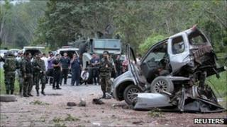 Security personnel at the site of the attack in Yala on 25 January 2010