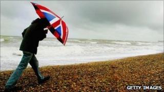 Man walking with Union flag umbrella