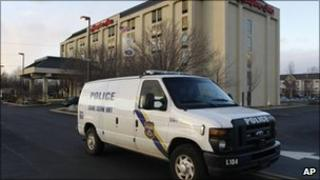 Philadelphia Police Department Crime Scene Unit vehicle pulls away from a Hampton Inn in Philadelphia, 8 Feb 2011