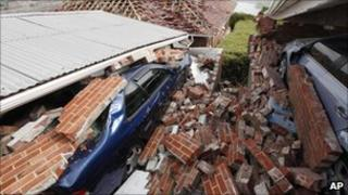 Cars crushed by rubble in a Christchurch suburb, 28 February 2011