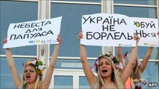 Activists of Ukrainian feminist movement Femen demonstrate in front of marriage registration office in central Kiev on 1 March 2011