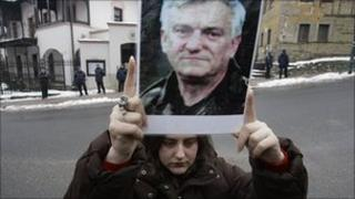 Protester holds picture of Jovan Divjak outside Austrian embassy in Sarajevo, Bosnia. 4 March 2011