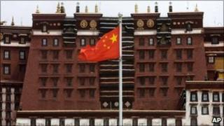 A Chinese flag flies over the square near the Potala Palace in Lhasa