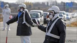 Police officers wearing respirators