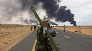 A rebel holds a portable air-defence system during clashes with pro-Gaddafi forces between Ras Lanuf and Bin Jawad, 9 March 2011