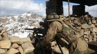 In this picture taken on Monday, March 7, 2011, a Pakistan army soldier takes position in the Pakistani tribal area of Datta Khel in North Waziristan where the Pakistan army are fighting against militants and al-Qaida activists along the Afghanistan border.