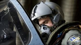 A pilot sits in the cockpit of a French Dassault Mirage 2000-5 aircraft before taking off on a mission to overfly Libyan airspace at Dijon base military handout March 19, 2011.