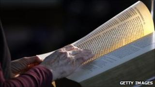 A women reads the King James Bible