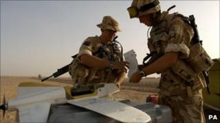 A British soldier prepares to launch an unmanned drone made by Lockheed Martin from camp Bastion in Helmand