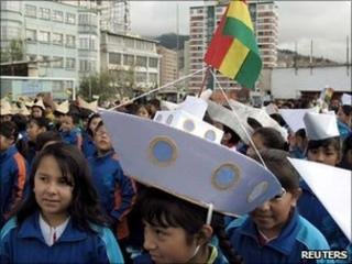 "Bolivian children parading on the ""Day of the Sea"" with paper hats shaped like ships"
