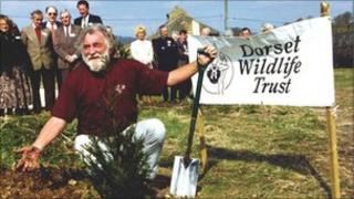 David Bellamy plants a tree to celebrate the opening of DWT's HQ at Brooklands Farm, Forston in 1995. Copyright of Dorset Wildlife Trust.