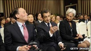 Chinese vice premier Wang Qishan with Nicolas Sarkozy and Christine Lagarde