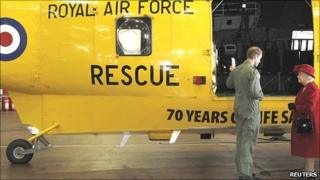 Prince William shows The Queen one of the SeaKing rescue helicopters