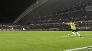 National team goal keeper Guan Zhen kicks the ball in a friendly against Costa Rica on 26 March 2011