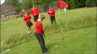School children playing golf
