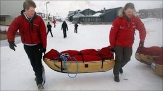 Prince Harry and Martin Hewitt load their kit before the flight to the Borneo Ice field