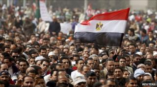 Protesters wave an Egyptian flag in Cairo