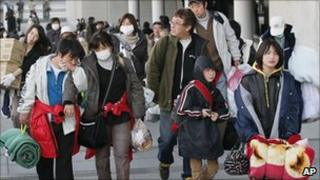 Futaba residents arrive at a shelter in Saitama on 19 March 2011