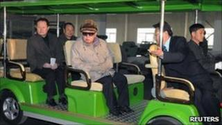 North Korean leader Kim Jong-il (C) visits the Amnokgang Tyre Factory; undated picture released by KCNA 7 April 2011