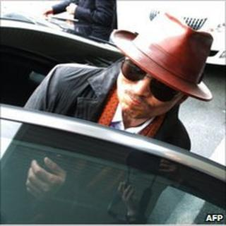 Kenichi Shinoda gets into a car after arriving at the train station in Kobe, western Japan on 9 April 2011